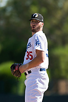 Glendale Desert Dogs relief pitcher Nolan Long (35), of the Los Angeles Dodgers organization, gets ready to deliver a pitch during an Arizona Fall League game against the Mesa Solar Sox at Camelback Ranch on October 15, 2018 in Glendale, Arizona. Mesa defeated Glendale 8-0. (Zachary Lucy/Four Seam Images)