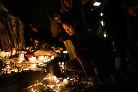 Paris, France, 15.11.2015. Francine Magtoto lives right next to Place de la Republique, and visits the square to light candles for the victims. Images from Paris in the aftermath of the devastating terror attacks on friday november 13. Photo: Christopher Olssøn