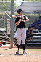 Brett Krill #15 of the San Francisco Giants plays in a minor league spring training game against the Chicago Cubs at the Cubs minor league complex on March 29, 2011  in Mesa, Arizona. .Photo by:  Bill Mitchell/Four Seam Images.