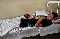 """A 16-year-old Honduran immigrant, having both his legs amputated by a train during an attempt to get illegally to the United States, lies on the bed in a refugee shelter in Tapachula, Mexico, 21 May 2011. Between 2010 and 2015, the US and Mexico have apprehended almost 1 million illegal immigrants from El Salvador, Honduras, and Guatemala. While the economic reasons remain the most frequent motivation for people from Central America to illegally immigrate to the US, thousands of Salvadorans, Guatemalans, and Hondurans, many of them minors, seek asylum in the US due to the thriving crime and gang-related violence in their region (known as the Northern Triangle). Taking an exhausting and risky journey, riding thousands of miles atop the cargo trains, facing a physical danger and extortion from the organized crime groups that control migrant routes, the """"undocumented"""" still flee to the US, looking for their American dream."""