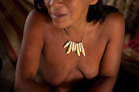 64 year old Nawade Caiga, a Waorani (Huaroni) woman wearing tapir teeth around her neck.