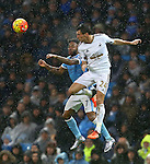 Raheem Sterling of Manchester City and Swansea's Jack Cork contest a header - Manchester City vs Swansea - Barclays Premier League - Etihad Stadium - Manchester - 12/12/2015 Pic Philip Oldham/SportImage