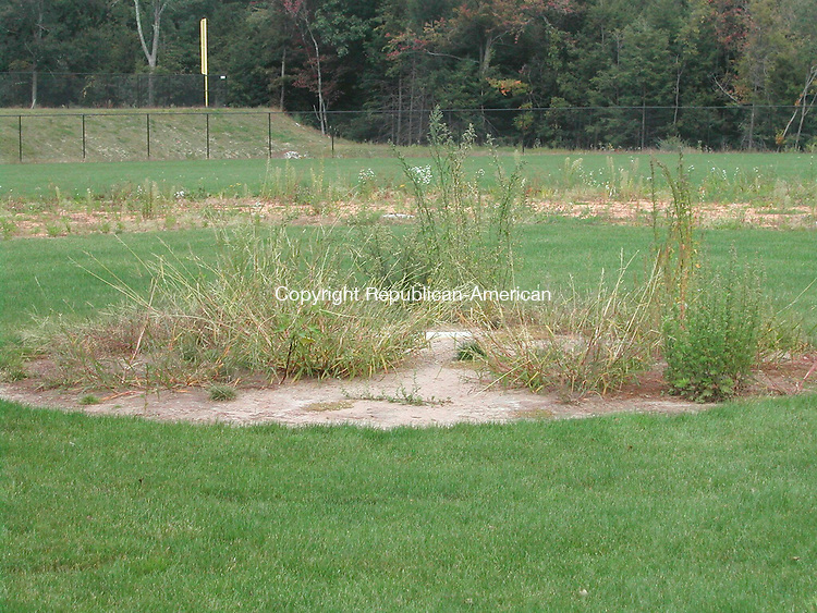 PLYMOUTH, CT - 23 Sept. 2008 - 092308KM01 - The pitcher's mound and base paths on the baseball field at the new Terryville High School are full of weeds. Superintendent of Schools Anthony W. Distasio said the baseball, softball and soccer fields are not in playable condition. He said the school building committee, which is overseeing the $38 million project, has not accepted the fields yet. The architect, Jeter Cook & Jepson in West Hartford, and the construction manager, Newington-based Industrial Construction, are expected to re-assess the fields with an environmental company and report back to the committee next month about whether the baseball and softball fields will be ready this spring. Kurt Moffett Republican-American