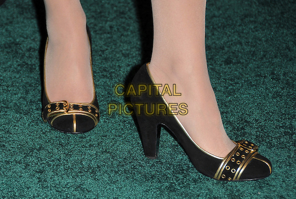 """KATRINA JACOB'S SHOES.Overature Pictures' L.A. Premiere of """"Mad Money"""" held at The Mann Village Theatre in Westwood, California, USA..January 9th, 2008.feet heels black gold detail buckle .CAP/DVS.©Debbie VanStory/Capital Pictures"""