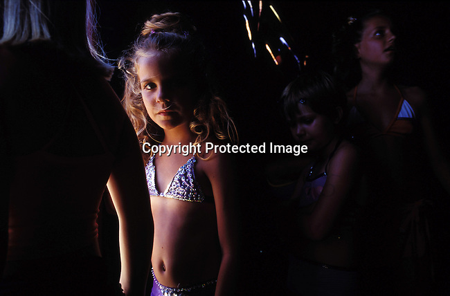 beauty,contest,pageant,miss,black,white,girls,youth,mixed,.Girls waiting backstage in a Miss Junior beauty contest at Margate Beach on January 2, 2004 in Margate, South Africa..©Per-Anders Pettersson/iAfrika Photos