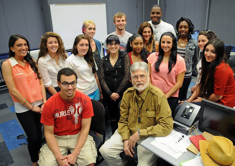 Class photo of instructor, Jim Peppler posed in the Blodgett Hall Room 119 Computer Lab, with students of his last Photojournalism class at Adelphi University in Garden City, NY on Thursday, May 17, 2012. <br /> Front Row- L-R- Joseph Diaz, and Peppler. 2ND Row-L-R- Melissa Mangiapanella, Emily Roca, Amber Ingargiola, Christine Cascio, Kimberly Ross, Heather Pergola, Erin Henry, and Anita Avakian. 3RD Row- L-R- Danielle Stockman, Henderson Hewes, Jessica Correale, Michael Irons (behind her) and Michelle Jean-Baptiste. Photo taken by Adelphi Communications  Dept. Administrative Assistant, Jessi Shaheen.  Photograph Copyright Jessi Shaheen/2012