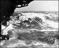 BNPS.co.uk (01202 558833)Pic: CharterhouseAuctioneers/BNPS<br /> <br /> HMS Fencer battling the rough seas.<br /> <br /> A remarkable wartime photo album that highlights the perilous nature of landing a fighter plane on an aircraft carrier in heavy seas has been unearthed.<br /> <br /> The black and white snaps show several Royal Naval aircraft coming a cropper while attempting to land on board HMS Fencer often in heavy seas.<br /> <br /> One set of images depict a Swordfish biplane crashing into the sea a few hundred yards off the aircraft carrier HMS Fencer.<br /> <br /> Other photos show a Supermarine Seafire about the crash into the superstructure.<br /> <br /> The album will be sold by Charterhouse Auctioneers in Sherborne, Dorset.