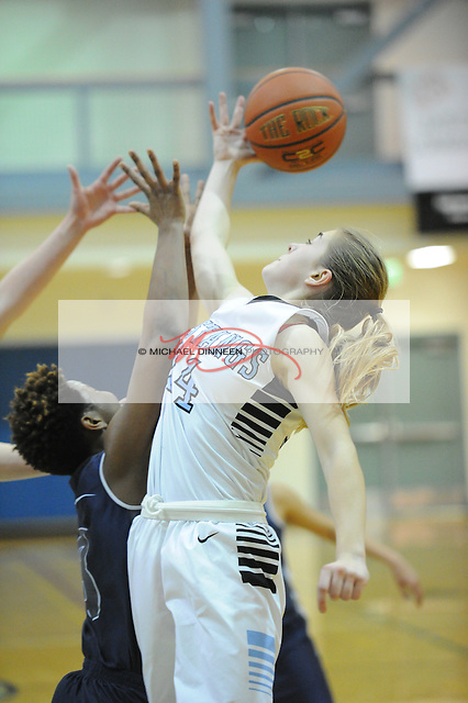Chugiak's Eva Palmer reaches for a rebound against Eagle River's Chyna Finley during their basketball game at Chugiak High School Tuesday, Jan. 10, 2017.  Photo for the Star by Michael Dinneen