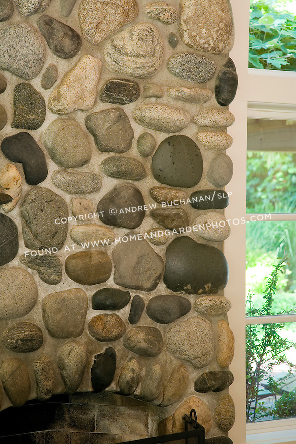 A detail shot of the rock and mortar work in the large fireplace and chimney of this waterfront weekend vacation retreat on Washington State's Vashon Island.