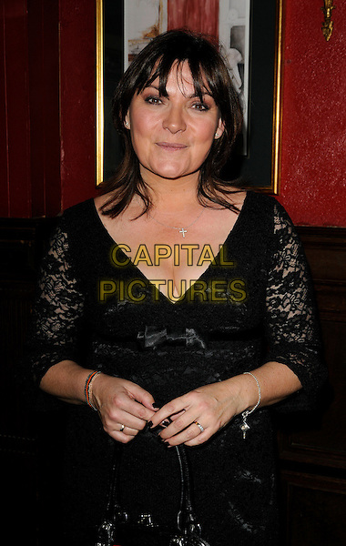 LORRAINE KELLY .The Johnny Walker Blue Label Great Scot Awards 2009, Boisdale bar & restaurant, London, England..January 26th, 2009.half length black lace dress sleeves cleavage nail varnish polish .CAP/CAN.©Can Nguyen/Capital Pictures.