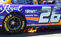 Apr 17, 2009; Avondale, AZ, USA; Flames come from the car of NASCAR Sprint Cup Series driver Jamie McMurray during practice for the Subway Fresh Fit 500 at Phoenix International Raceway. Mandatory Credit: Mark J. Rebilas-