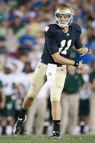 Notre Dame quarterback Tommy Rees (#11) throws pass in action during NCAA football game between Notre Dame and South Florida.  The South Florida Bulls defeated the Notre Dame Fighting Irish 23-20 in game at Notre Dame Stadium in South Bend, Indiana.