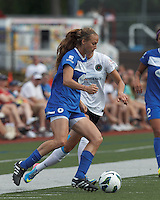 Boston Breakers midfielder Heather O'Reilly (9) passes the ball as Portland Thorns FC defender Marian Dougherty (2) defends. In a National Women's Soccer League (NWSL) match, Portland Thorns FC (white/black) defeated Boston Breakers (blue), 2-1, at Dilboy Stadium on July 21, 2013.