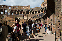 Tourists make their way through the ruins of the Colosseum on Wednesday, Sept. 23, 2015, in Rome, Italy. (Photo by James Brosher)