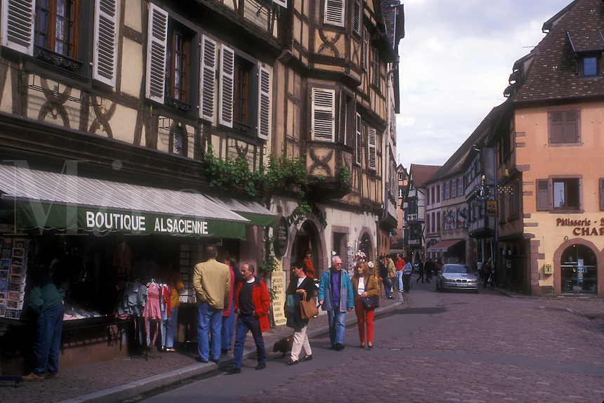 AJ1650, Alsace, France, Kaysersberg, Europe, People shopping in boutiques in the picturesque village of Kaysersberg with its half-timbered houses that line the narrow cobbled streets, a wine growing village of Alsace, France.