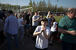 Visiting supporters celebrating at the final whistle after Ilkeston Town (in red) hosted Walsall Wood in a Midland Football League premier division match at the New Manor Ground, Ilkeston. The home team were formed in 2017 taking the place of Ilkeston FC which had been wound up earlier that year. Watched by a crowd of 1587, their highest of the season, the match was top versus second, however, the visitors won 4-0 and replaced their hosts at the top of the division on goal difference with two matches to play