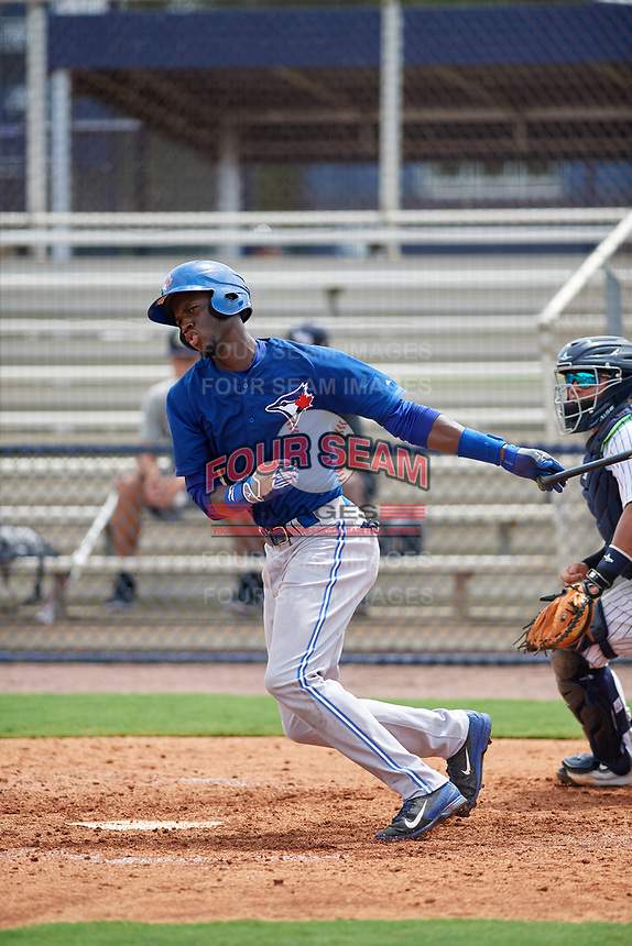 GCL Blue Jays right fielder Aldo Ovando (71) follows through on a swing during the first game of a doubleheader against the GCL Yankees East on July 24, 2017 at the Yankees Minor League Complex in Tampa, Florida.  GCL Blue Jays defeated the GCL Yankees East 6-3 in a game that originally started on July 8th.  (Mike Janes/Four Seam Images)