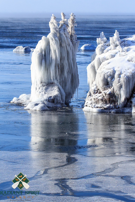 &quot;Icy Sea Stack at Tettegouche State Park&quot;<br /> <br /> Spray from Lake Superior's big waves on subzero days freeze on everything they touch, creating fantastic ice sculptures. It's amazing that the trees atop the sea stack and along the shore can endure the harsh conditions. This sea stack used to be connected to the mainland with the iconic stone arch until the arch crumbled into the lake in 2010. Tettegouche State Park, Minnesota, Lake Superior.