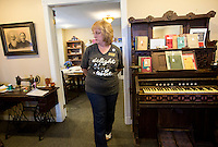 NWA Democrat-Gazette/JASON IVESTER <br /> Museum director Elizabeth Estes describes on Thursday, Sept. 17, 2015, some of the artifacts on display inside the Lowell Historical Museum.
