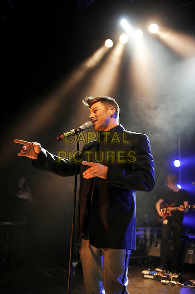Duncan James of Blue.Blue performing in concert, Shepherd's Bush Empire, London, England, UK, 3rd May 2013.music concert gig live on stage audience half length singing microphone black jacket hand finger pointing .CAP/MAR.© Martin Harris/Capital Pictures.