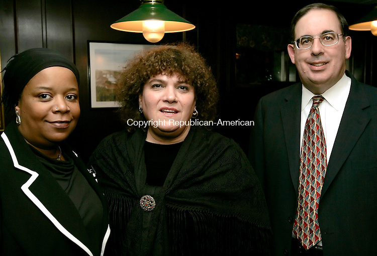 WATERBURY, CT - 20 OCTOBER 2005 -102005JS08- Keynote speaker Lori Powell of Waterbury, left, board member Marie Johnston, center and Board of Director President Frank Travisano at the Central Naugatuck Valley Help, Inc., 35th anniversary dinner Thursday at The Hills Restaurant at Western Hills Golf Course in Waterbury. --Jim Shannon Republican-American--Lori Powell; Marie Johnston; Frank Travisano; Central Naugatuck Valley Help; Inc., Western Hills Golf Course, Waterbury are CQ