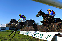 Flaminger ridden by Leighton Aspell leads De Plotting Shed ridden by Jamie Moore in The Download The Racing Post App Novices' Chase during Horse Racing at Plumpton Racecourse on 2nd December 2019