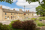 A row of historic stone cottages in  in the Saxon town of Cricklade, Wiltshire, England, UK