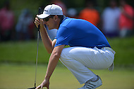 Bethesda, MD - June 28, 2014: Justin Rose eyes his putt on hole 8 in Round 3 of the Quicken Loans National at the Congressional Country Club in Bethesda, MD, June 28, 2014.  (Photo by Don Baxter/Media Images International)