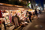 Visitors look at merchandise on sale in the trendy neighborhood of Kichijoji in Musashino City,  Tokyo, Japan on 16 Sept. 2012.  Photographer: Robert Gilhooly