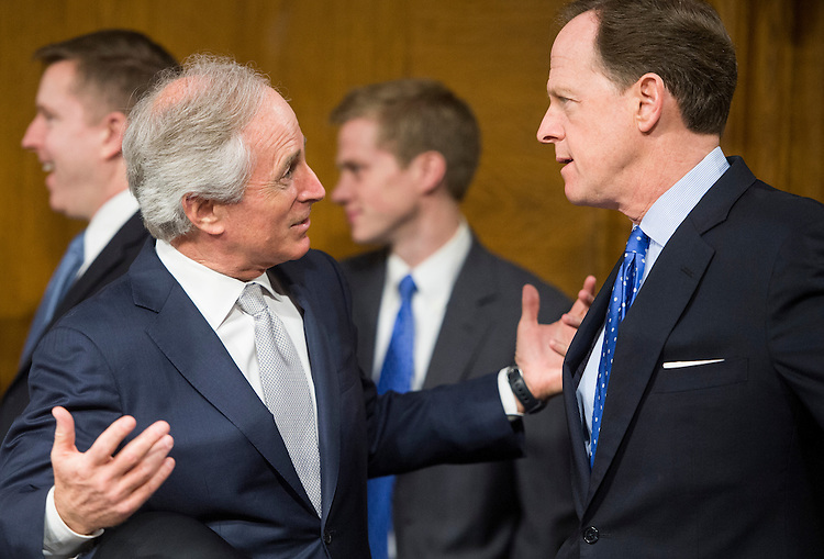 UNITED STATES - FEBRUARY 26: From left, Sen. Bob Corker, R-Tenn., speaks with Sen. Pat Toomey, R-Pa., before the start of the Senate Banking, Housing and Urban Affairs Committee hearing with Federal Reserve Chairman Ben Bernanke on Capitol Hill on Tuesday, Feb. 26, 2013. (Photo By Bill Clark/CQ Roll Call)