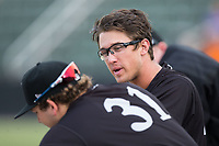 Blake Rutherford (right) chats with teammate Jake Burger (31) during the game against the Greensboro Grasshoppers at Kannapolis Intimidators Stadium on August 13, 2017 in Kannapolis, North Carolina.  The Grasshoppers defeated the Intimidators 3-0.  (Brian Westerholt/Four Seam Images)