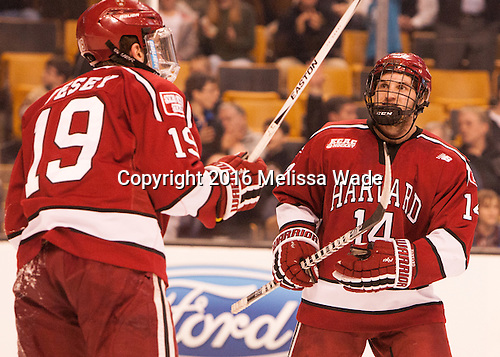 Jimmy Vesey (Harvard - 19) and Alexander Kerfoot (Harvard - 14) celebrate Criscuolo's goal. - The Boston College Eagles defeated the Harvard University Crimson 3-2 in the opening round of the Beanpot on Monday, February 1, 2016, at TD Garden in Boston, Massachusetts.