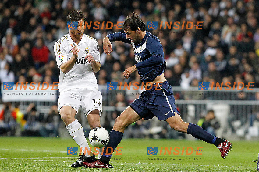 Real Madrid's Xabi Alonso (l) and Malaga's Ruud Van Nistelrooy during Spanish King's Cup match.January 3,2011. (Insidefoto/ALTERPHOTOS/Acero) .Madrid 3/1/2012 Stadio Santiago Bernabeu.Cppa del Re.Real Madrid Malaga