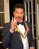 Lionel Richie, one of he five recipients of the 40th Annual Kennedy Center Honors with his award as he poses for a group photo following a dinner hosted by United States Secretary of State Rex Tillerson in their honor at the US Department of State in Washington, D.C. on Saturday, December 2, 2017. The 2017 honorees are: American dancer and choreographer Carmen de Lavallade; Cuban American singer-songwriter and actress Gloria Estefan; American hip hop artist and entertainment icon LL COOL J; American television writer and producer Norman Lear; and American musician and record producer Lionel Richie.  <br /> Credit: Ron Sachs / Pool via CNP