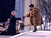 "United States President-elect Bill Clinton shakes hands with entertainer Aretha Franklin at the concert at the Lincoln Memorial that was part of the ""American Reunion"" celebration on the National Mall on January 17, 1993.<br /> Credit: Howard L. Sachs / CNP"