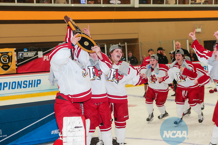 ADRIAN, MI - MARCH 18: The Plattsburgh State team celebrate with the championship trophy after winning the Division III Women's Ice Hockey Championship held at Arrington Ice Arena on March 19, 2017 in Adrian, Michigan. Plattsburgh State defeated Adrian 4-3 in overtime to repeat as national champions for the fourth consecutive year. by Tony Ding/NCAA Photos via Getty Images)