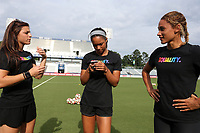 Cary, North Carolina  - Saturday June 17, 2017: NC Courage players (from left) Sabrina D'Angelo, Darian Jenkins, and Lynn Williams wear Nike Equality BeTrue Tees before a regular season National Women's Soccer League (NWSL) match between the North Carolina Courage and the Boston Breakers at Sahlen's Stadium at WakeMed Soccer Park. The Courage won the game 3-1.