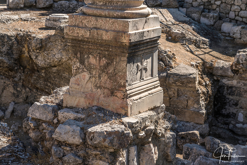 A Byzantine pillar among ruins of the Roman baths next to the Church of Saint Anne and the Bethesda Pools in the Muslim Quarter of the Old City of Jerusalem.  The Old City of Jerusalem and its Walls is a UNESCO World Heritage Site.