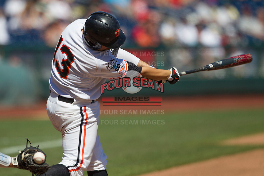 Oregon State catcher Jake Rodriguez (13) swings the bat against the Louisville Cardinals during Game 5 of the 2013 Men's College World Series on June 17, 2013 at TD Ameritrade Park in Omaha, Nebraska. The Beavers defeated Cardinals 11-4, eliminating Louisville from the tournament. (Andrew Woolley/Four Seam Images)