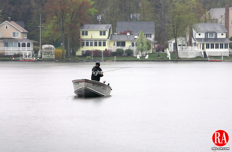 WINSTED, CT-25 APRIL 2010-042510JS01-Sunday's cooler tempratures and rain did not deter this fisherman from going out on Highland Lake in Winsted. Rain in forecasted for the area through Tuesday morning. <br /> Jim Shannon Republican-American
