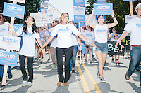 Supporters of Democratic presidential candidate Bernie Sanders march in the Labor Day parade in Milford, New Hampshire.  Republican candidates John Kasich, Carly Fiorina, and Lindsey Graham also marched in the parade.