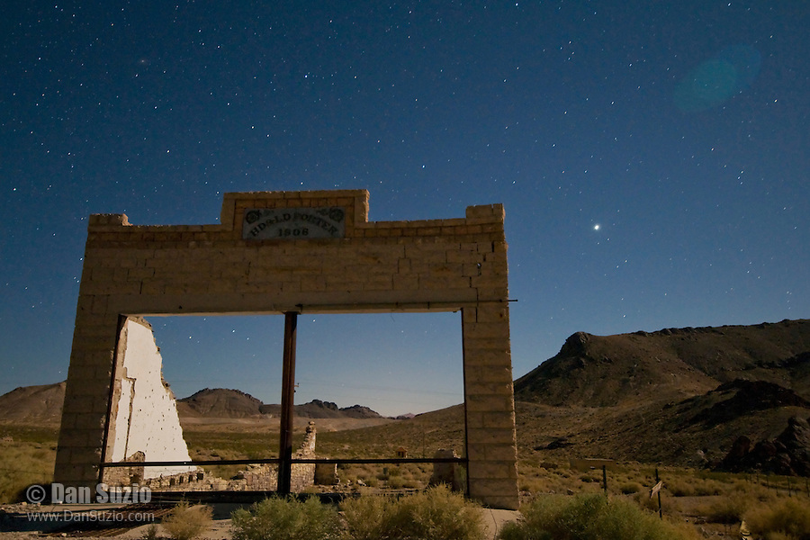Moonlit ruins of the Porter Brothers Store building in the ghost town of Rhyolite, Nevada, a mining boomtown that, at its peak between 1905 and 1912, had a population of 5,000 to 10,000.