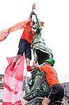 21 June 2006: Holland fans climb a statue in the fountain in Frankfurt's town square. The Netherlands played Argentina at Commerzbank Arena in Frankfurt, Germany in match 37, a Group C first round game, of the 2006 FIFA World Cup.