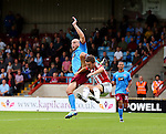 David Mirfin of Scunthorpe Utd fouls Stefan Scougall of Sheffield Utd to concede a penalty during the English League One match at Glanford Park Stadium, Scunthorpe. Picture date: September 24th, 2016. Pic Simon Bellis/Sportimage