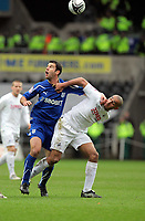 ATTENTION SPORTS PICTURE DESK<br /> Pictured: Darren Pratley of Swansea (R) challenged by Dekel Keinen of Cardiff (L).<br /> Re: npower Championship Swansea City FC v Cardiff City FC at the Liberty Stadium, south Wales. Sunday 06 February 2011