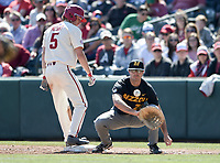 NWA Democrat-Gazette/CHARLIE KAIJO Arkansas Razorbacks infielder Jacob Nesbit (5) runs to first as University of Missouri infielder Tony Ortiz (28) catches during a baseball game, Sunday, March 17, 2019 at Baum-Walker Stadium in Fayetteville.