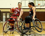 MARSHALL, MN - MARCH 15:  Arinn Young #13 from Alabama tries to make a move against Emily Oberst #32 from Illinois at the 2018 National Intercollegiate Wheelchair Basketball Tournament at Southwest Minnesota State University in Marshall, MN. (Photo by Dave Eggen/Inertia)