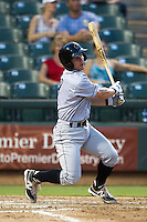 Omaha Storm Chasers second baseman Johnny Giavotella #9 swings during the Pacific Coast League baseball game against the Round Rock Express on July 22, 2012 at the Dell Diamond in Round Rock, Texas. The Express defeated the Chasers 8-7 in 11 innings. (Andrew Woolley/Four Seam Images).