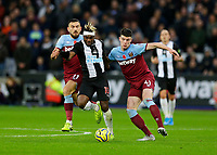 2nd November 2019; London Stadium, London, England; English Premier League Football, West Ham United versus Newcastle United; Declan Rice of West Ham United challenges Allan Saint-Maximin of Newcastle United - Strictly Editorial Use Only. No use with unauthorized audio, video, data, fixture lists, club/league logos or 'live' services. Online in-match use limited to 120 images, no video emulation. No use in betting, games or single club/league/player publications