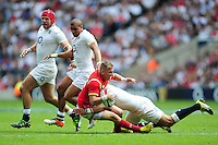 Gareth Anscombe of Wales is tackled to ground. Old Mutual Wealth Cup International match between England and Wales on May 29, 2016 at Twickenham Stadium in London, England. Photo by: Patrick Khachfe / Onside Images